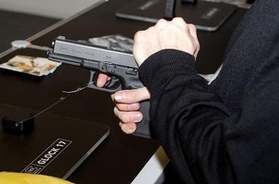 The best glock trigger man holding a gun