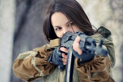 lady holding a gun